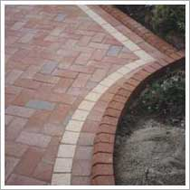 curver border to the new block pave driveway