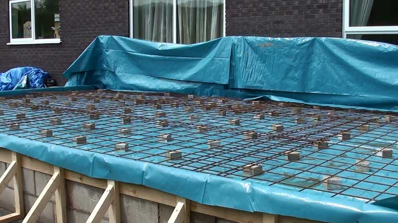 Visquuen sheeting was fixed to the wall to stop any splashing when the concrete is being placed in position