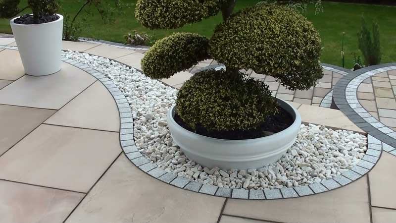 Close up showing the detail round the cloud tree and the decorative pebbles and granite border detail