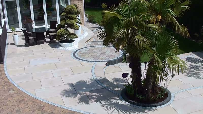 The completed Fairstone king size garden patio with a eclipse granite border detail