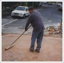 brush kiln dried sand in the joints of the block paving