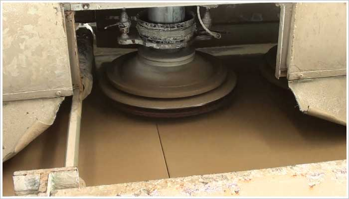 A line polisher is a machine that has a series of rotating heads that gently abrade or polish the surface of the stone. The surface finish is achieved by using a coarse abrasive nylon or diamond tipped brush depending on the type of finish you want