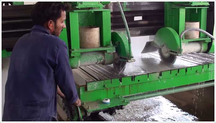 Multi blade edge cutting saw to speed up the process of cutting the stone to the correct size, the saw blades can be positioned to the desired width required and the saw just runs down the stone sheet and trims the edges.