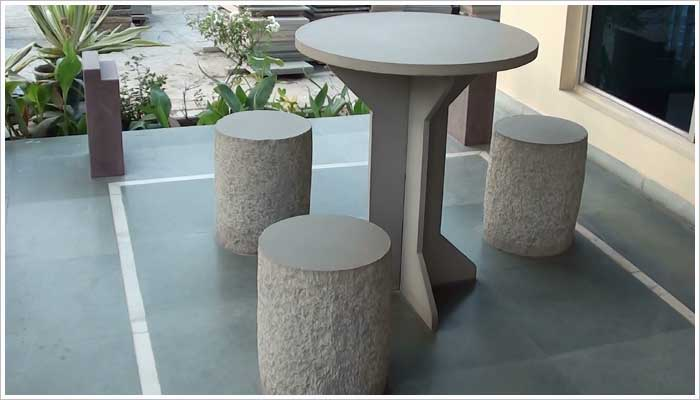 Patio table and stools made out of stone