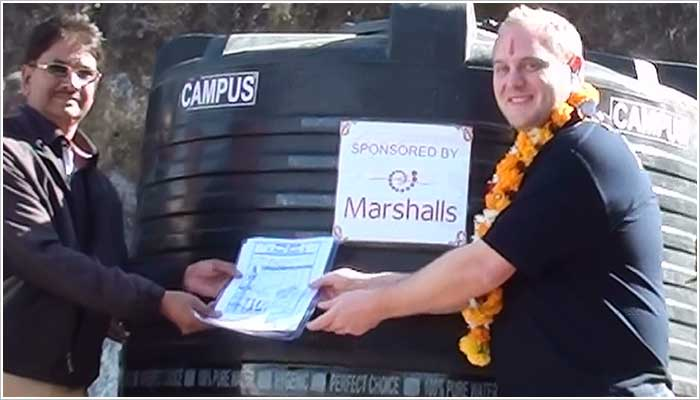 Marshall's had a dress down day during 2013 raising money for this school, below is a photo of water storage tank being donated to the head teacher by Chris Frankland from Marshalls