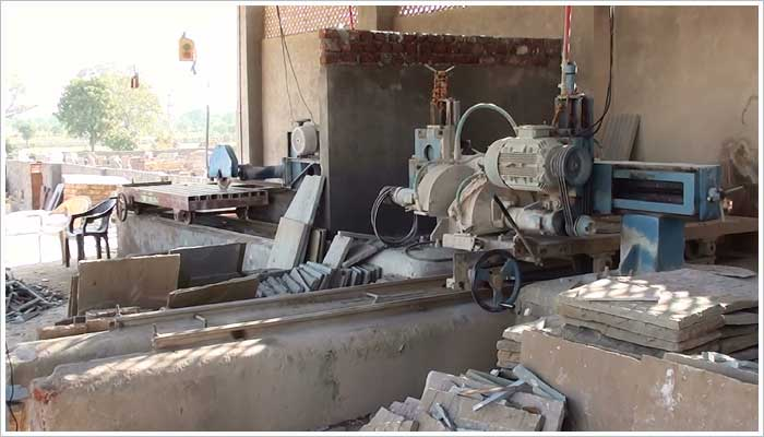 Some of the stone saws being used to make saw cuts to the rear side of the riven paving
