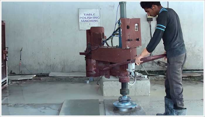 This process uses water and an assortment of abrasive disks to leave a very smooth polished surface to the stone. This machine is similar to a line polisher, but using only one head and a manual brush over the surface.