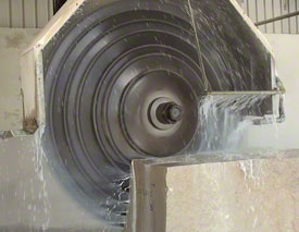 Multi head saw cutting blocks of stone into strips