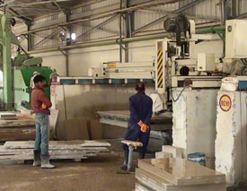 Crosscut saws cutting the stone to size
